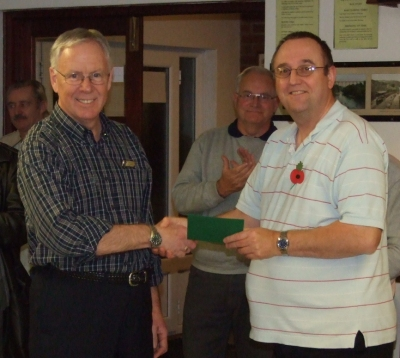 Gary Barling presents £50 for the Hospice